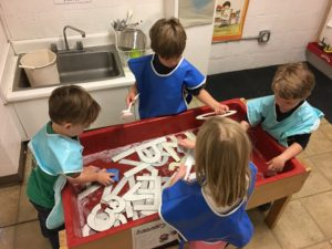 four's -sensory table (letters)